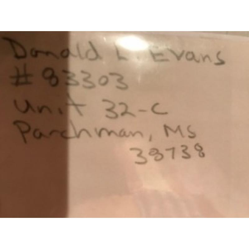 Donald Leroy Evans handwritten envelope with numerous lines penned by him from 1998